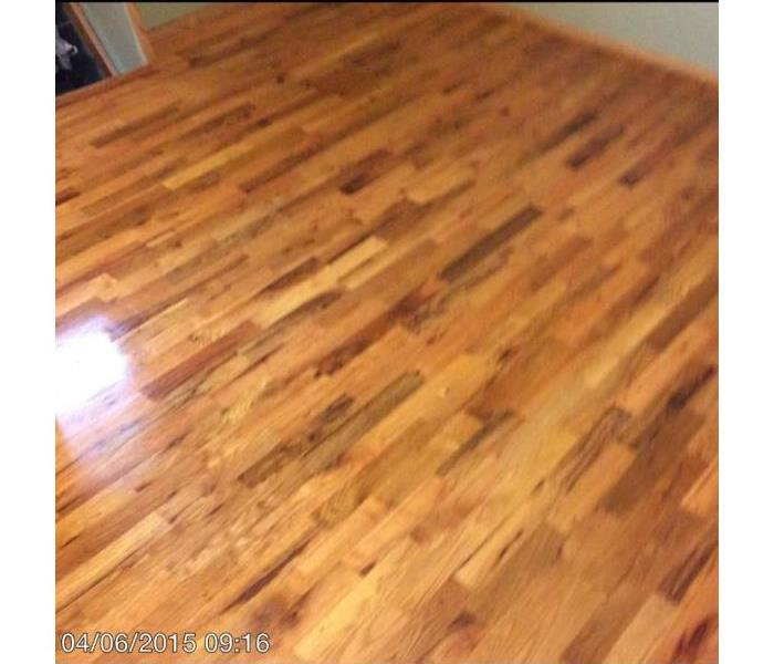 Hardwood floor restored after water damage